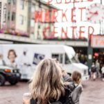 woman standing in pike place market